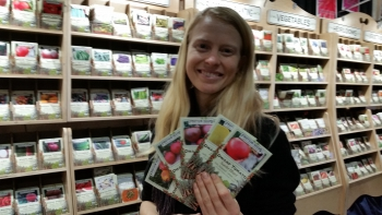 Petra Page-Mann of Fruition Seeds shows packets of regionally adapted seeds.
