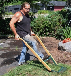 """Rich Oliver of Perennial Harmony, Waterford, CT uses a manual """"sod kicker"""" to clear ground."""